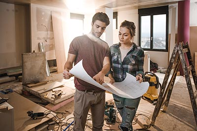 Young couple studying remodeling plans
