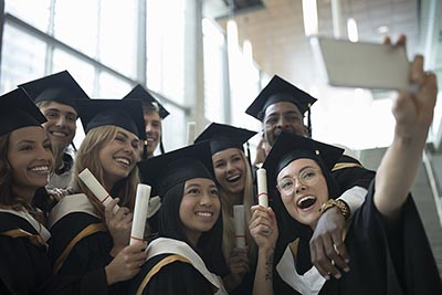 A group of new college graduates in caps and gowns